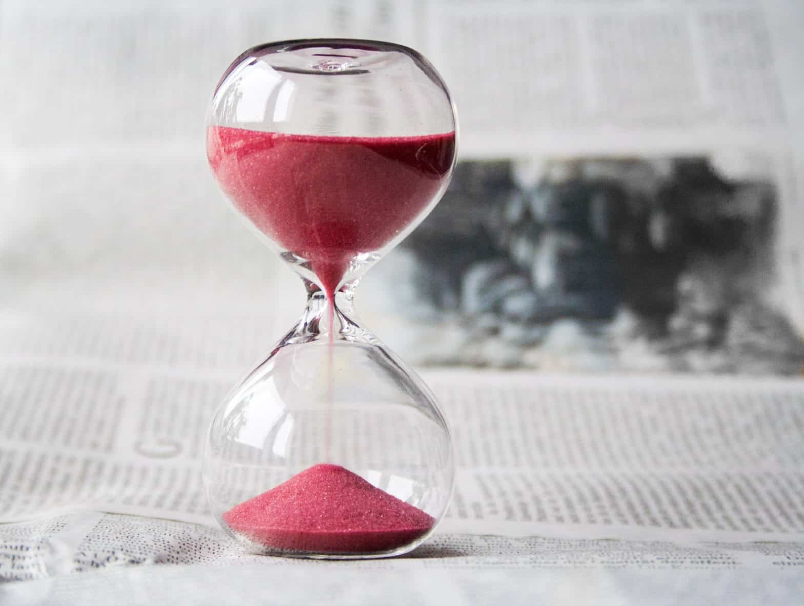 An hourglass running out of time as a deadline approaches.