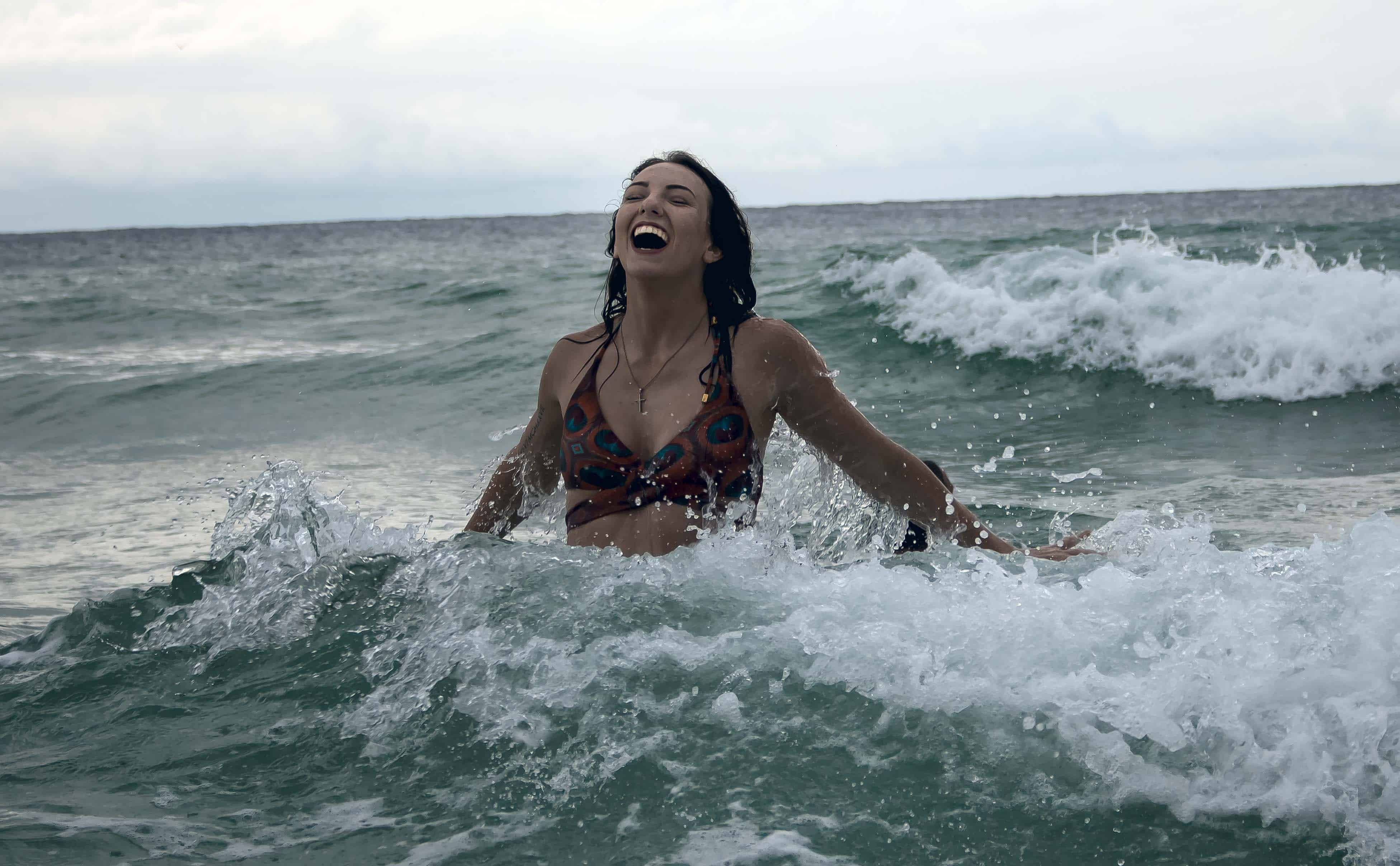 A woman enjoying her self in the ocean, living for the weekend.