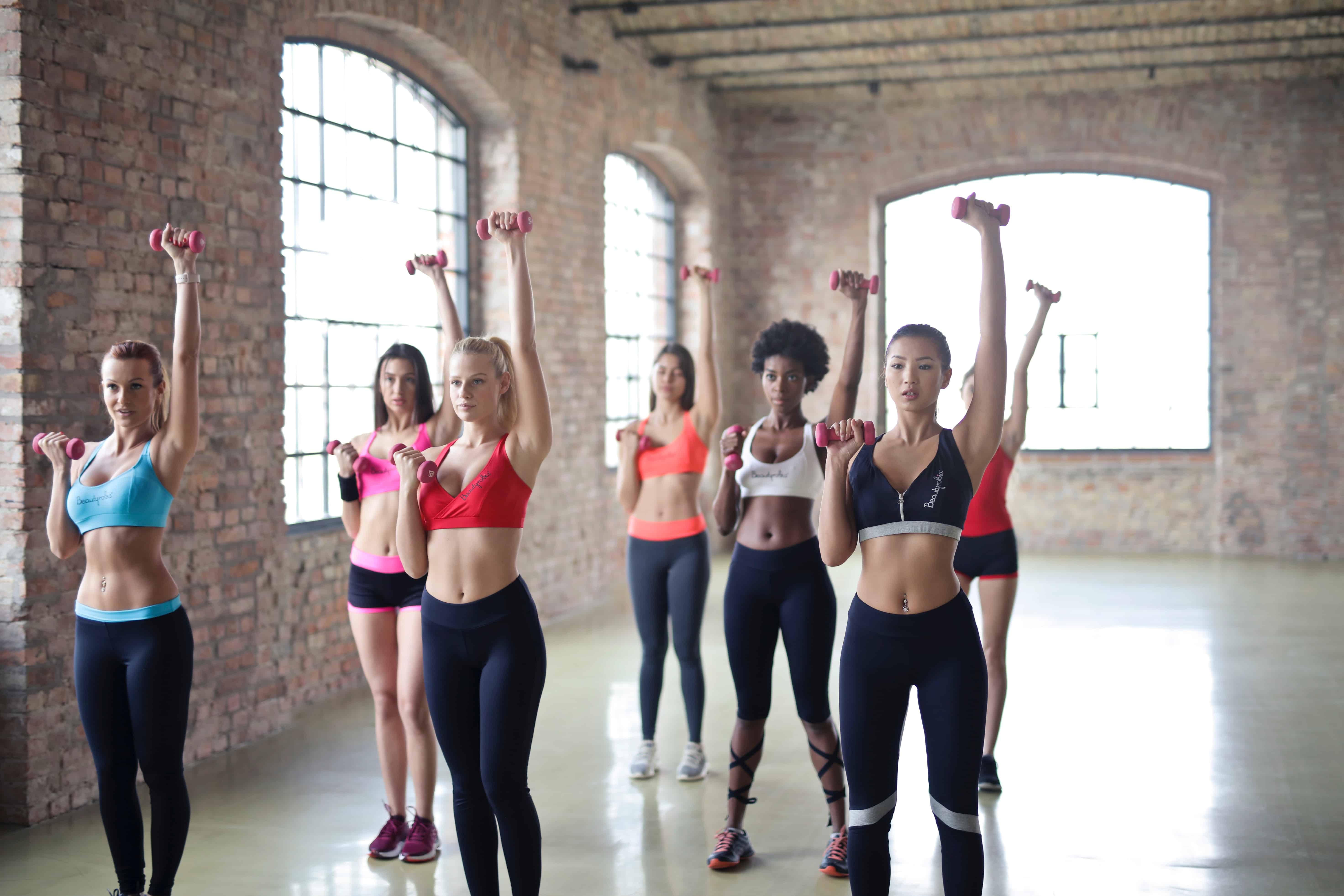A group of women exercising together.