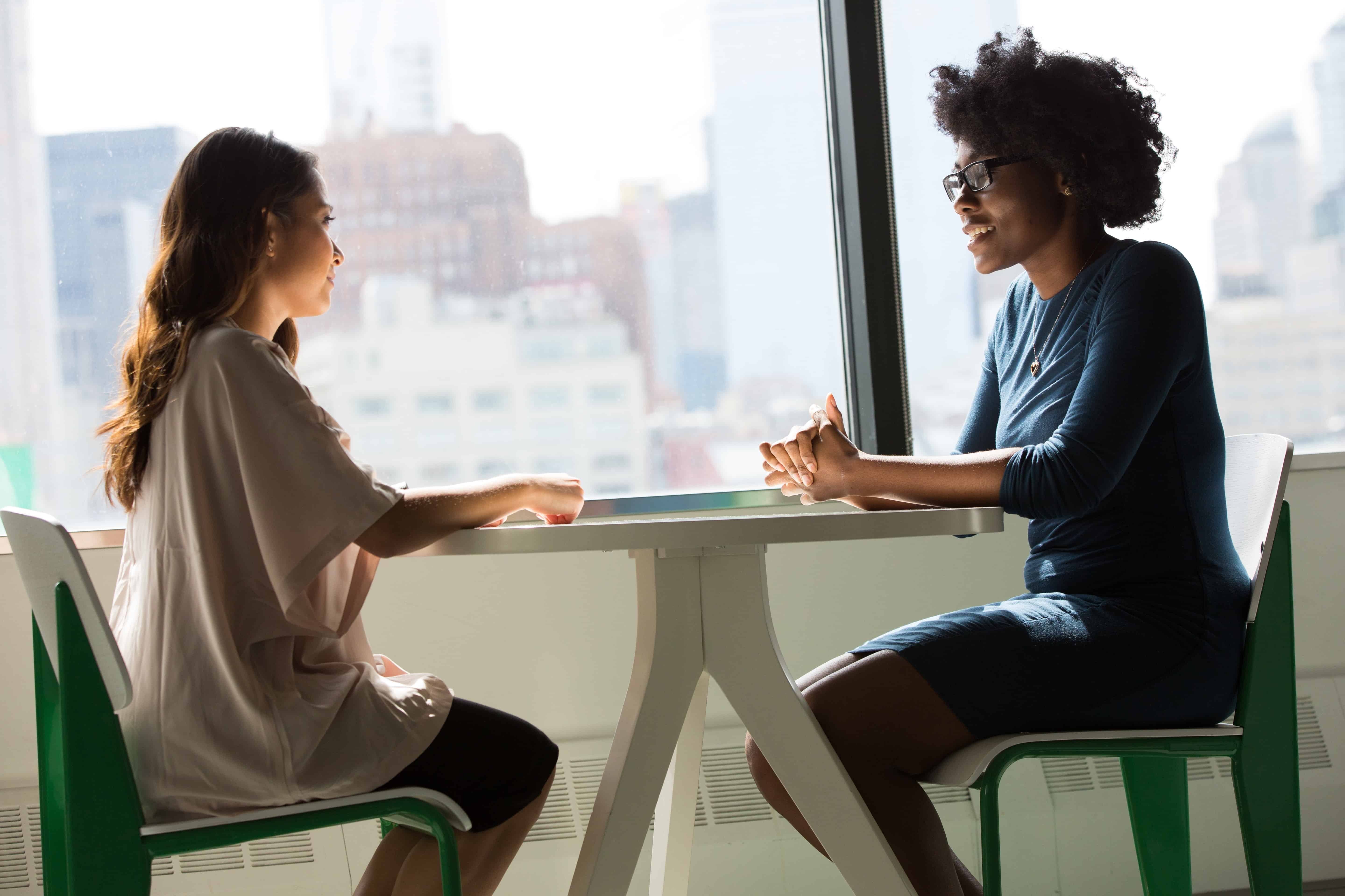 Two women communicating effectively in the work place