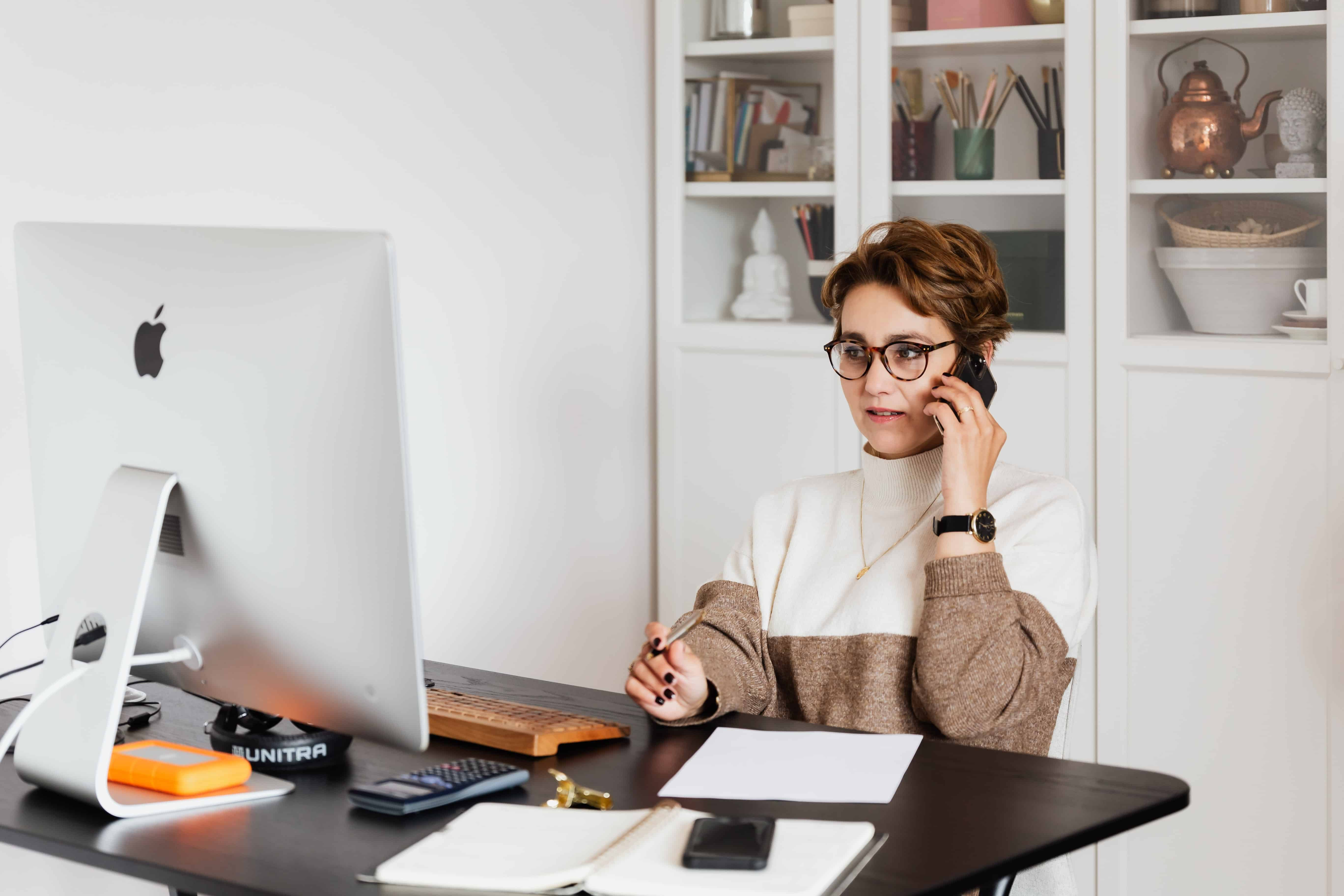 A woman using time management to prioritize work tasks.