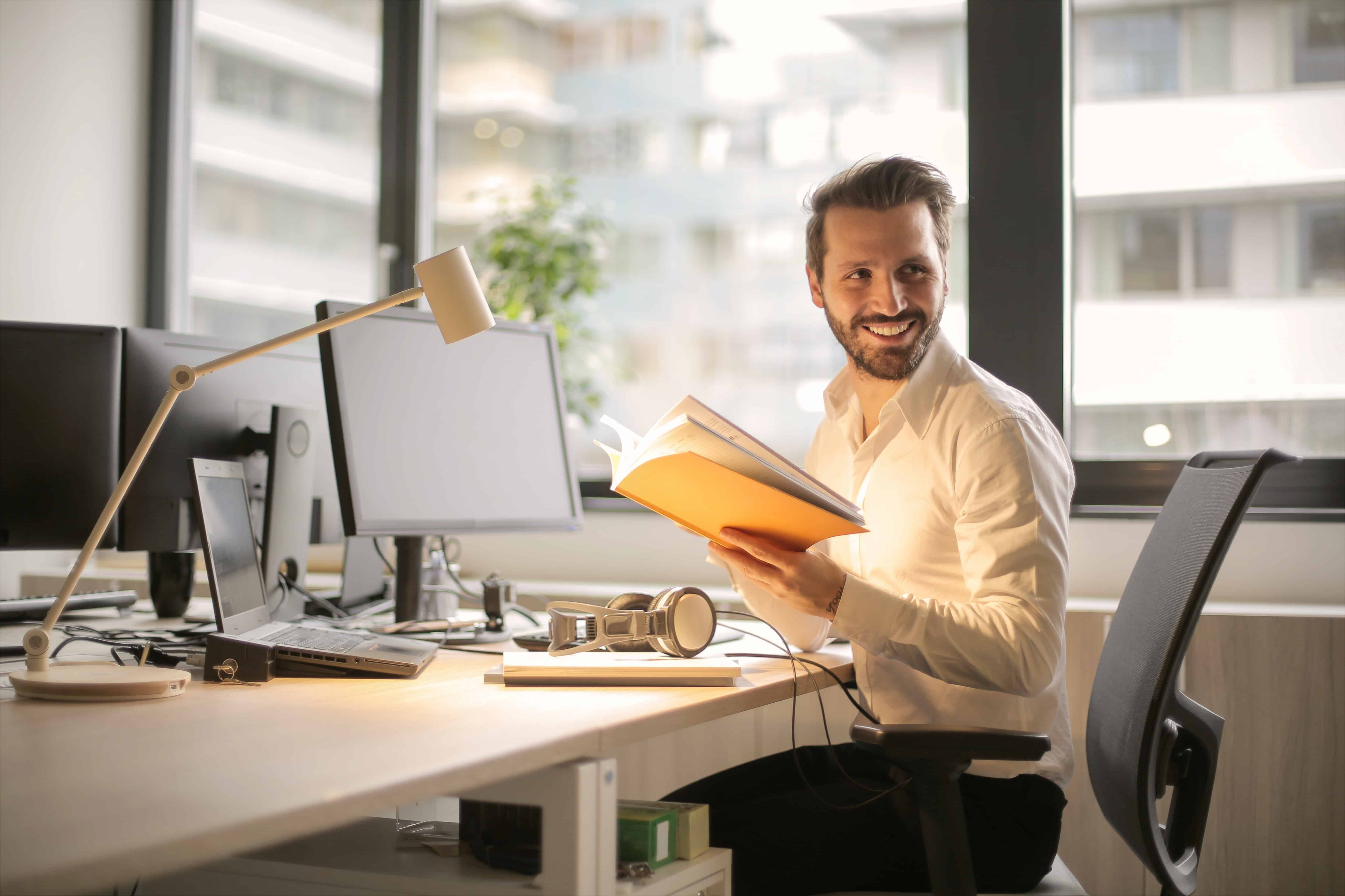 A man who is happy in the workplace.